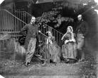 Black-and-white photograph of Victorian family in a garden