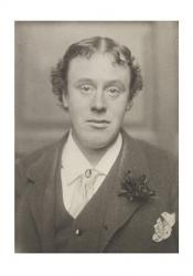 Black and white portrait photograph of Eric Stenbock circa 1886. Wikimedia Commons.